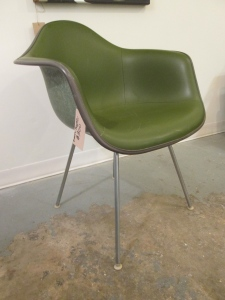 "Eames shell chair in olive green naughahyde with an ""H style"" base."